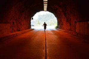man_running_in_tunnel_goals_start